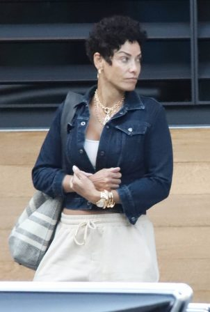 Nicole Murphy - Seen with mystery man at Ocean Prime in a vintage car in Beverly Hills