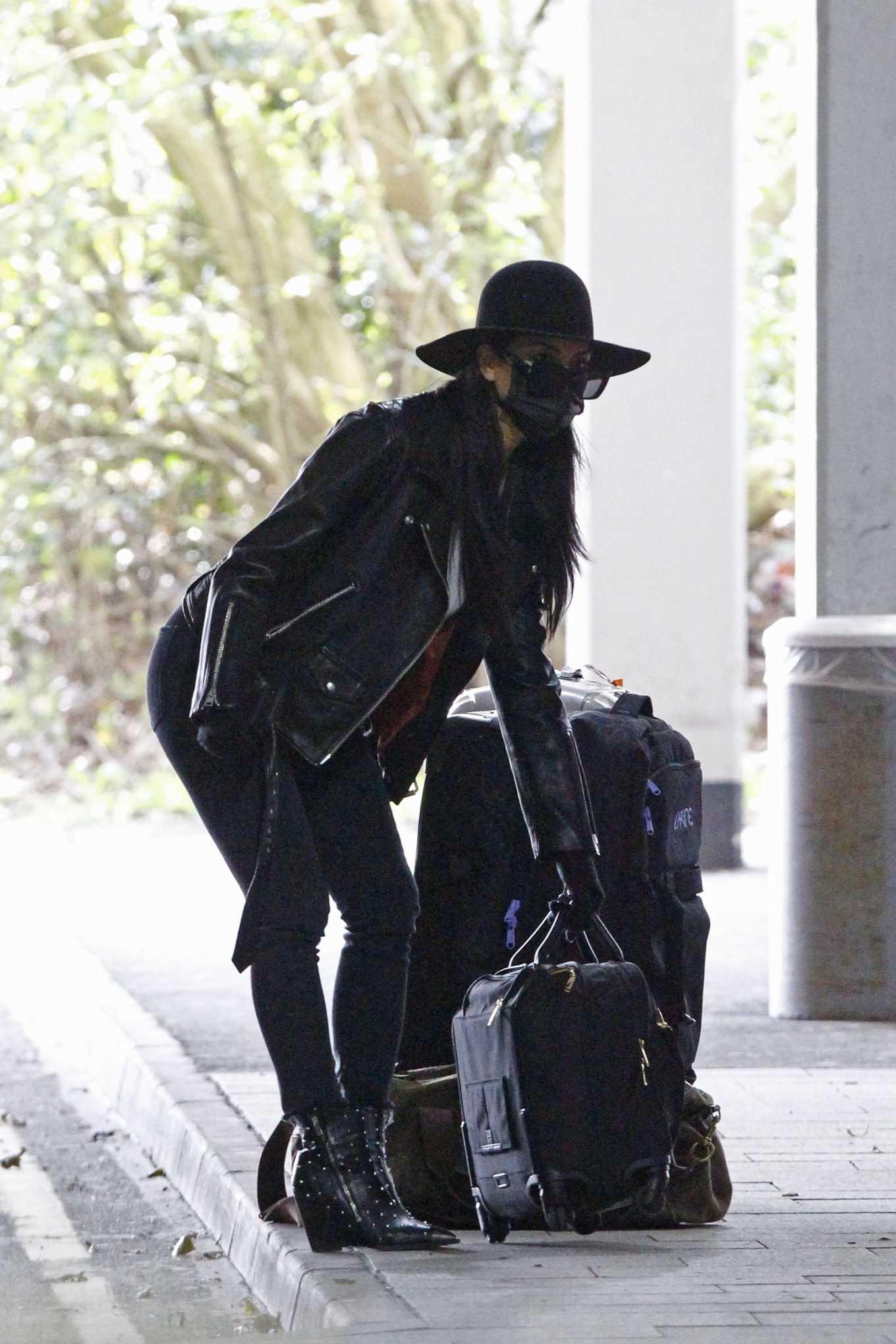 Nicole Scherzinger - Flying out of Heathrow Airport