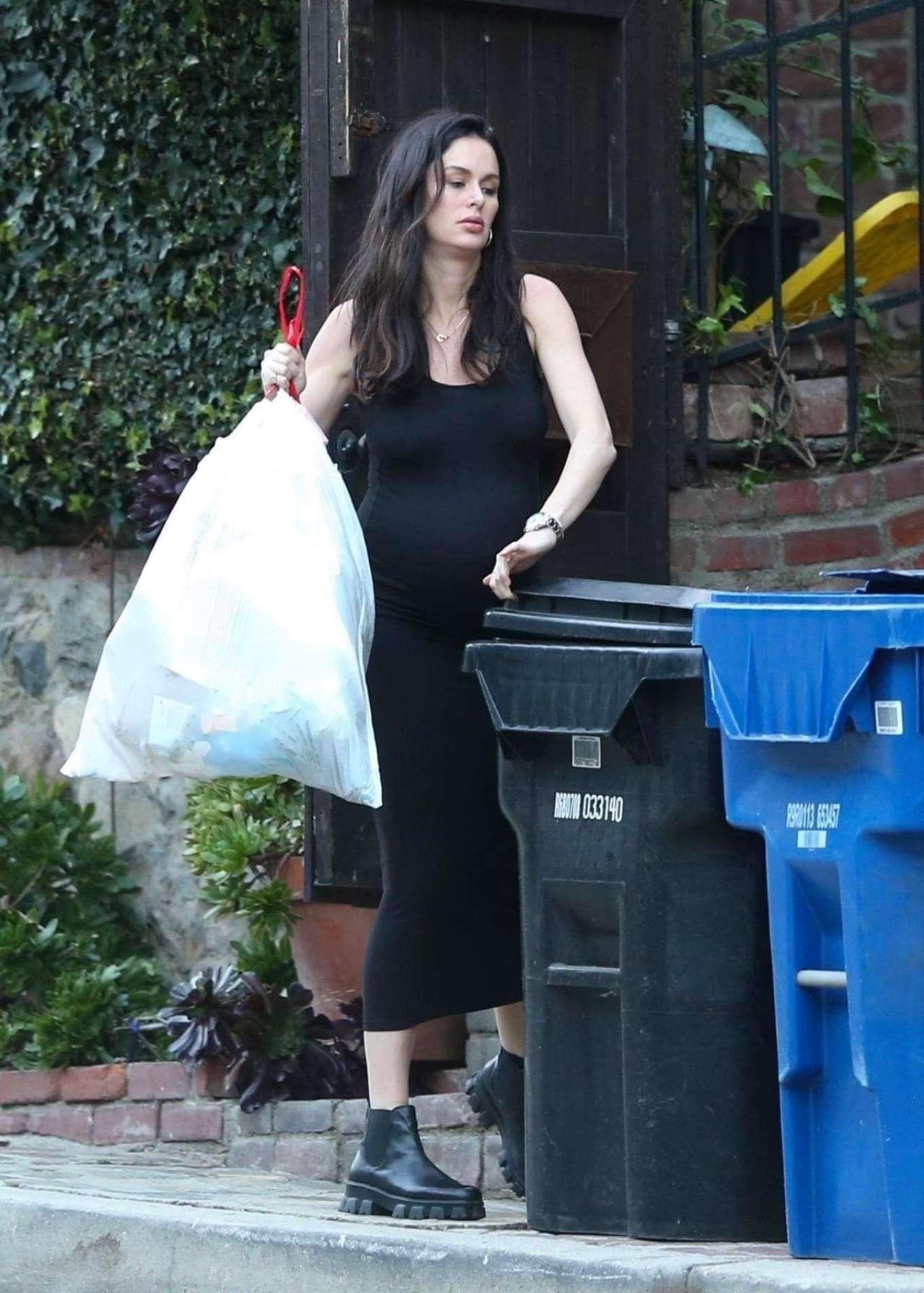 Nicole Trunfio taking out the trash