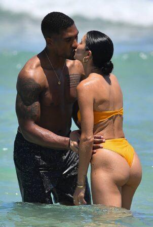 Nicole Williams - Seen in a orange swimsuit at the beach in Miami