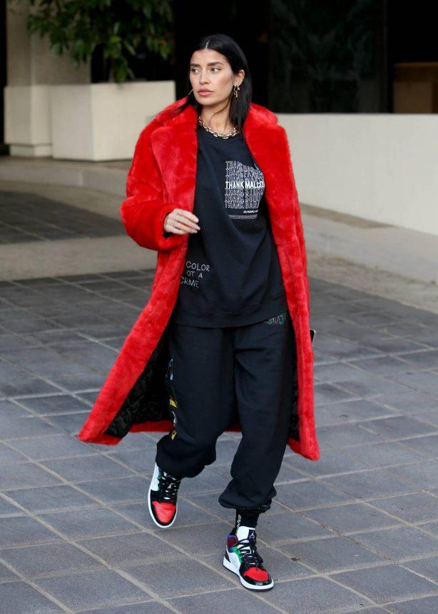 Nicole Williams - Wears an oversized Phillip Plein Coat in Century City