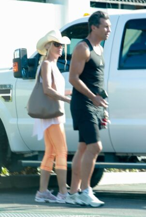 Nicollette Sheridan - With a mystery man shopping at The Commons in Calabasas