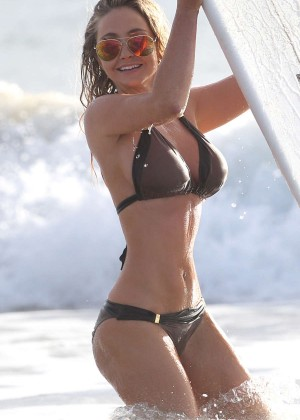 Nikki Lund in Bikini Surfing on Miami Beach