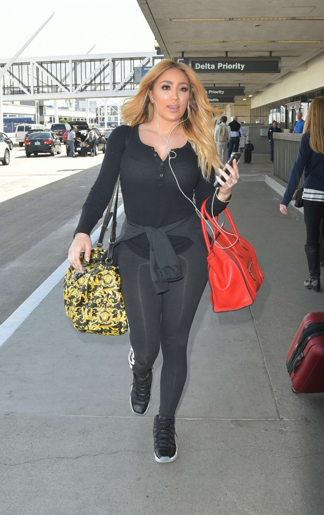 Nikki Mugarris - Arrives at LAX Airport in Los Angeles