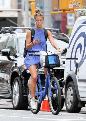 Nina Agdal in Short Dress Riding Bikes in New York