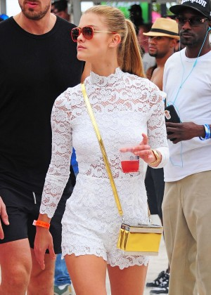 Nina Agdal in White Shorts On the beach in Miami