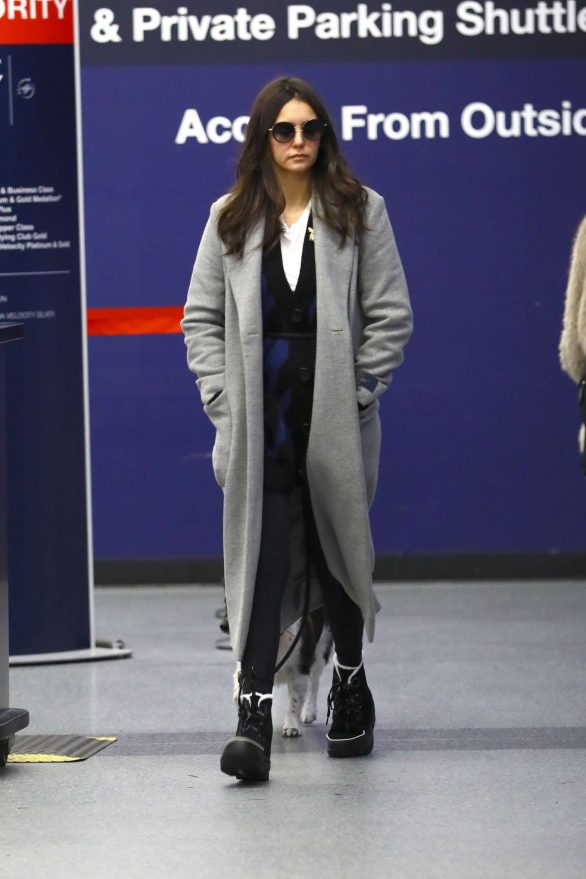 Nina Dobrev - Arrives at LAX airport in Los Angeles