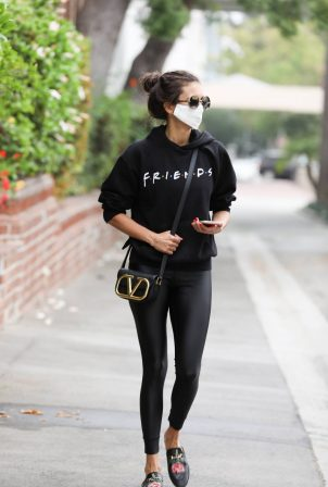 Nina Dobrev - In all black seen running errands in Los Angeles