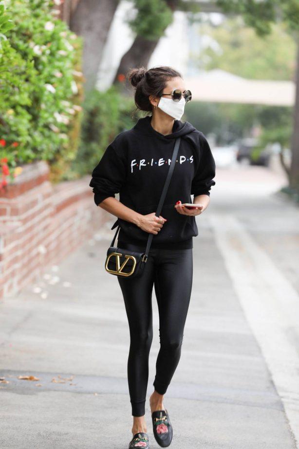 Nina Dobrev - In all black seen running errands in Los Angeles
