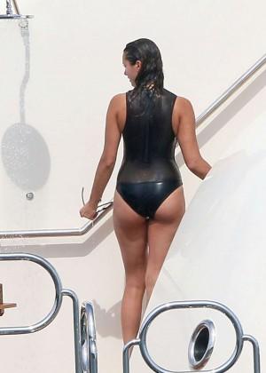 Nina Dobrev in Black Swimsuit -06