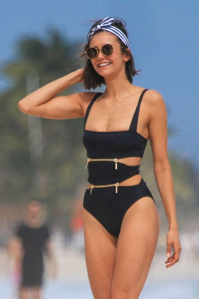 Nina Dobrev in Black Swimsuit on the beach in Tulum