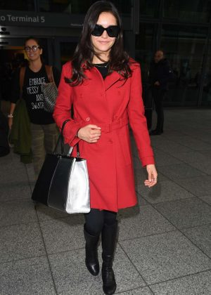 Nina Dobrev in Red Coat at Heathrow Airport in London