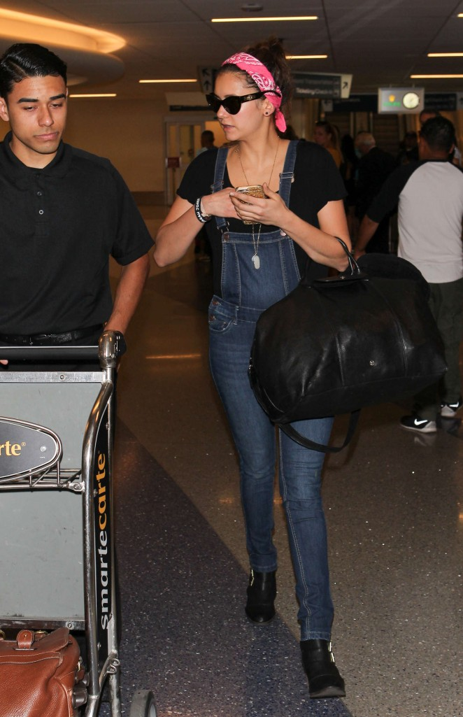Nina Dobrev in Tight Jeans at LAX Airport in LA