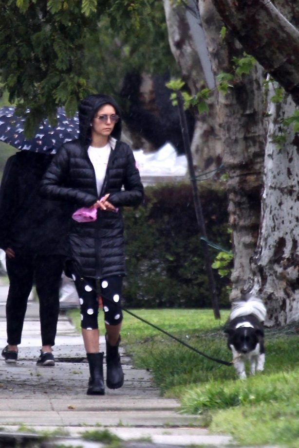 Nina Dobrev take her dog Maverick out for a walk