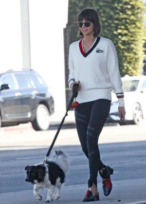 Nina Dobrev - Takes her dog Maverick for a walk in LA