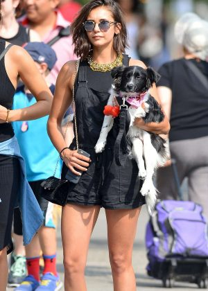Nina Dobrev - Takes her dog Maverick out for a walk in NYC