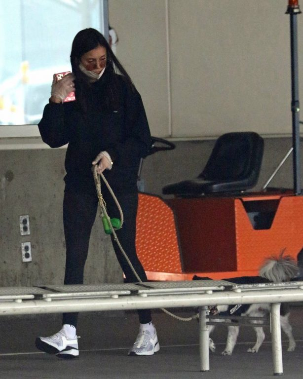 Nina Dobrev - With her pup arrives into Vancouver airport