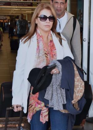 Olga Tanon Arrives at LMM Airport in San Juan