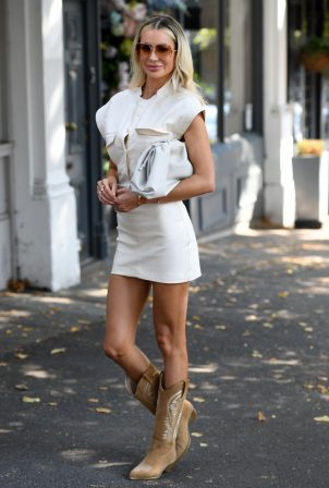 Olivia Attwood - Leggy in white dress while out in London