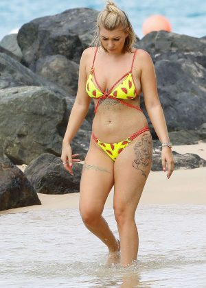 Olivia Buckland in Bikini at the beach in Barbados