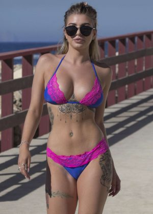 Olivia Buckland in Bikini on the beach in Marbella