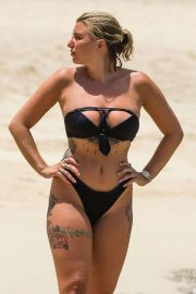 Olivia Buckland in Black Bikini on the beach in Barbados