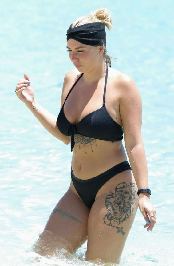 Olivia Buckland in Black Bikini with Alex Bowen on the beach in Barbados