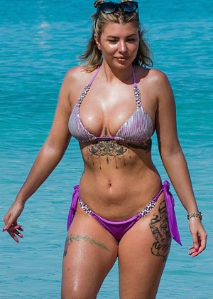 Olivia Buckland in Purple Bikini on the beach in Barbados