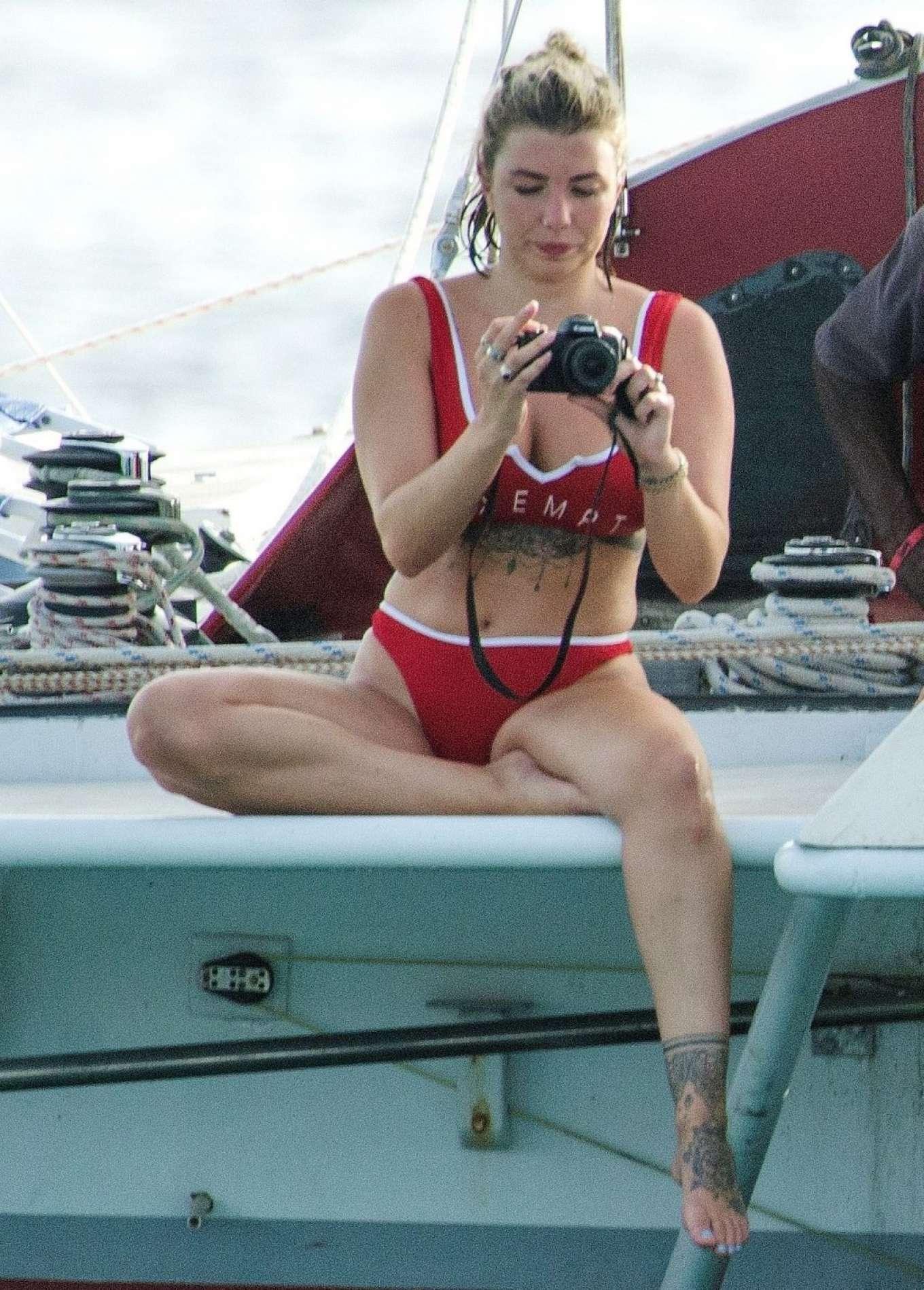 Olivia Buckland in Red Bikini on the beach in Barbados