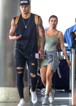 Olivia Buckland in Short Dress at Airport in Barbados