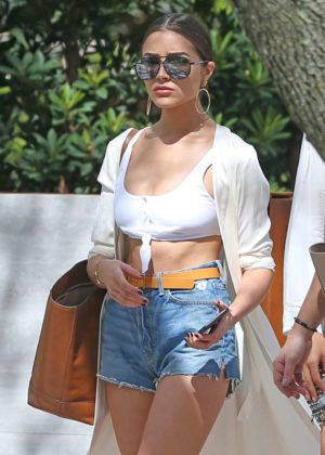 Olivia Culpo and Devon Windsor with friends leaving Devon's home in Miami