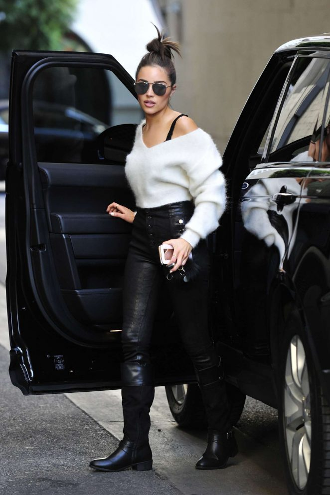 Olivia Culpo getting out of her black Range Rover