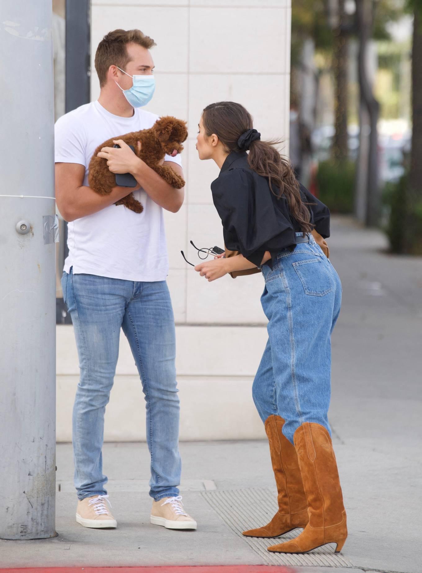 Olivia Culpo 2021 : Olivia Culpo – Dons cowboy boots at Valentino in Beverly Hills-05