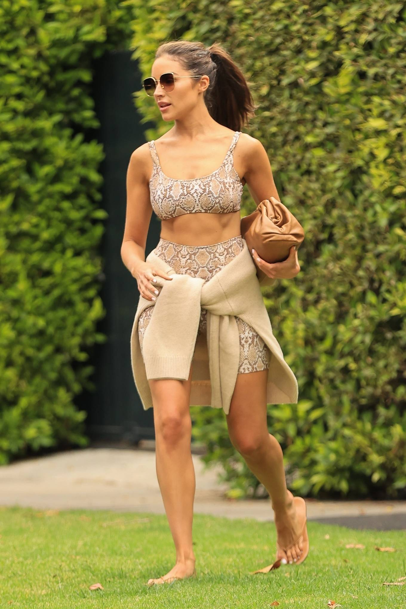 Olivia Culpo - In a snake print workout top and shorts while out in West Hollywood
