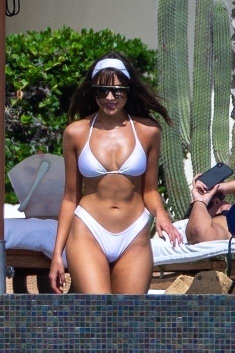 Olivia Culpo - In a white bikini poolside in Cabo San Lucas