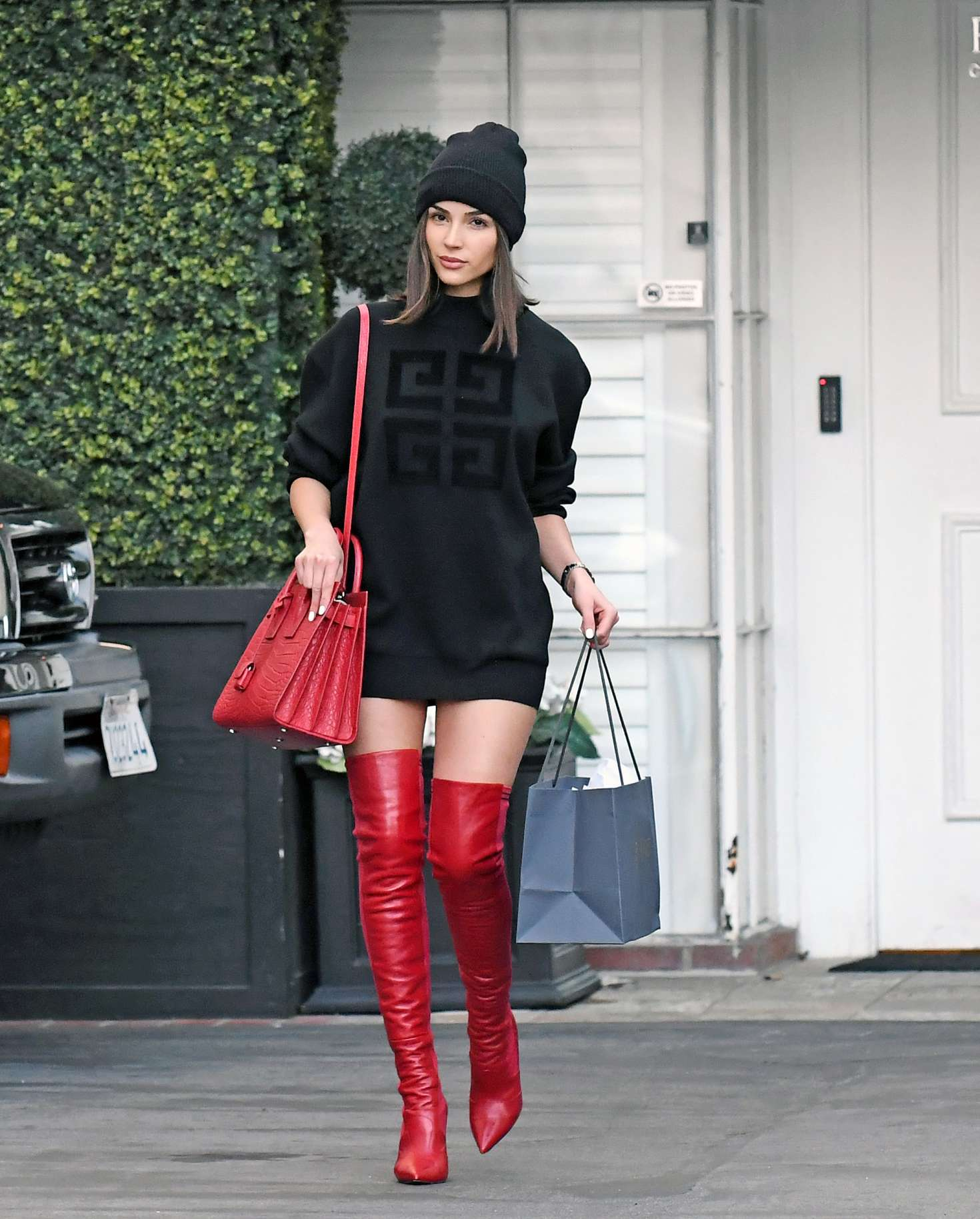 Olivia Culpo in Mini Dress and Red Boots – Shopping at Epione in Beverly Hills