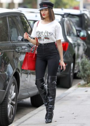 Olivia Culpo in Over knee boots and Jeans in Los Angeles