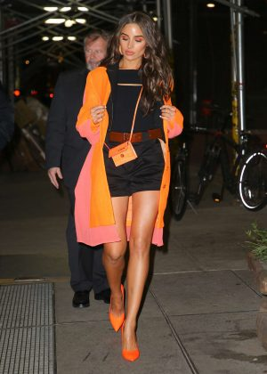 Olivia Culpo in Shorts and Orange Coat - Out in New York City
