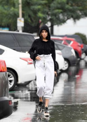 Olivia Culpo out in the rain for grocery shopping in LA