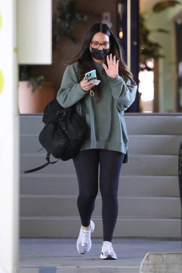 Olivia Munn - In a green sweatshirt and black leggings in Santa Monica