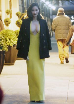 Olivia Munn in Long Yellow Dress Leaves her hotel in New York