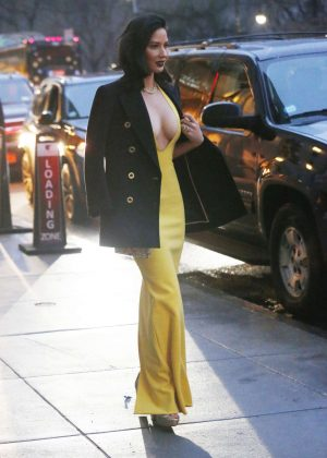 Olivia Munn In Long Yellow Dress Leaves Her Hotel In New