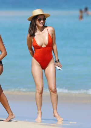 Olivia Munn in Red Swimsuit on the beach in Hawaii