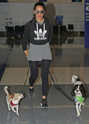 Olivia Munn with her two dogs Leaving Los Angeles