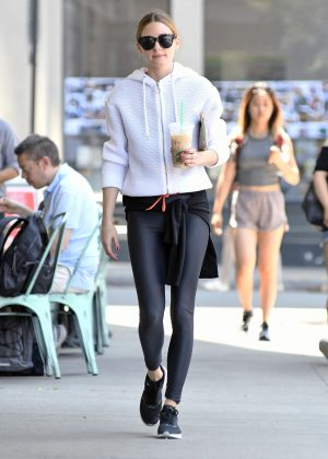 Olivia Palermo in spandex getting iced coffee in Brooklyn