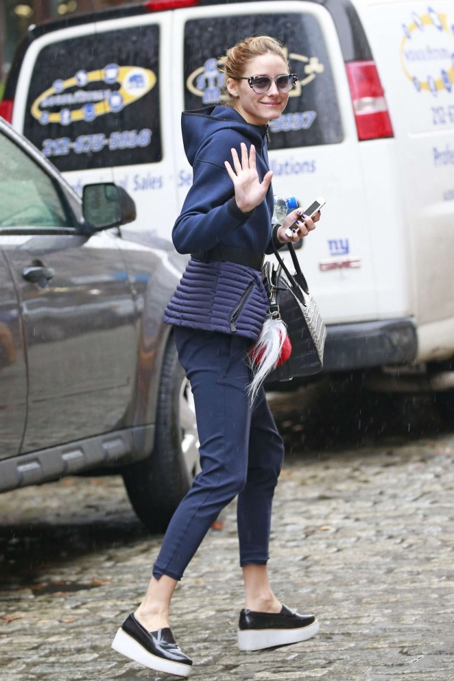 Olivia Palermo getting into a yellow cab -03