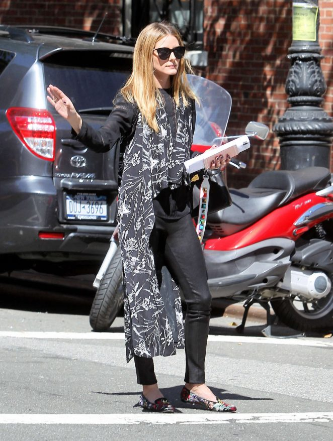 Olivia Palermo hail a cab in New York City