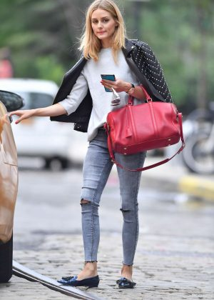 Olivia Palermo in jeans hailing a cab in New York