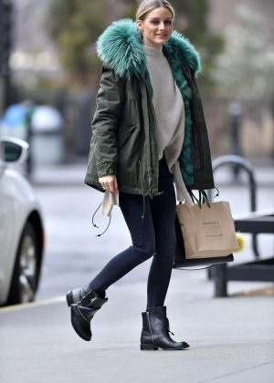 Olivia Palermo in a green jacket and black boots out in Brooklyn