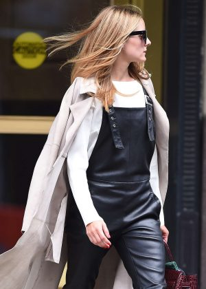 Olivia Palermo in black leather overalls in Brooklyn